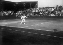 30th June 1914: Australian tennis player Norman Brookes in action against A E Beamish at the Wimbledon Lawn Tennis Championships. (Photo by Topical Press Agency/Getty Images)